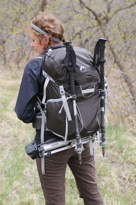 Karisa with the photosport 30l, ready for adventuring.