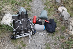 Switch out the tripod for a sleeping bag, add in a mess kit and some food, and you are good to go!